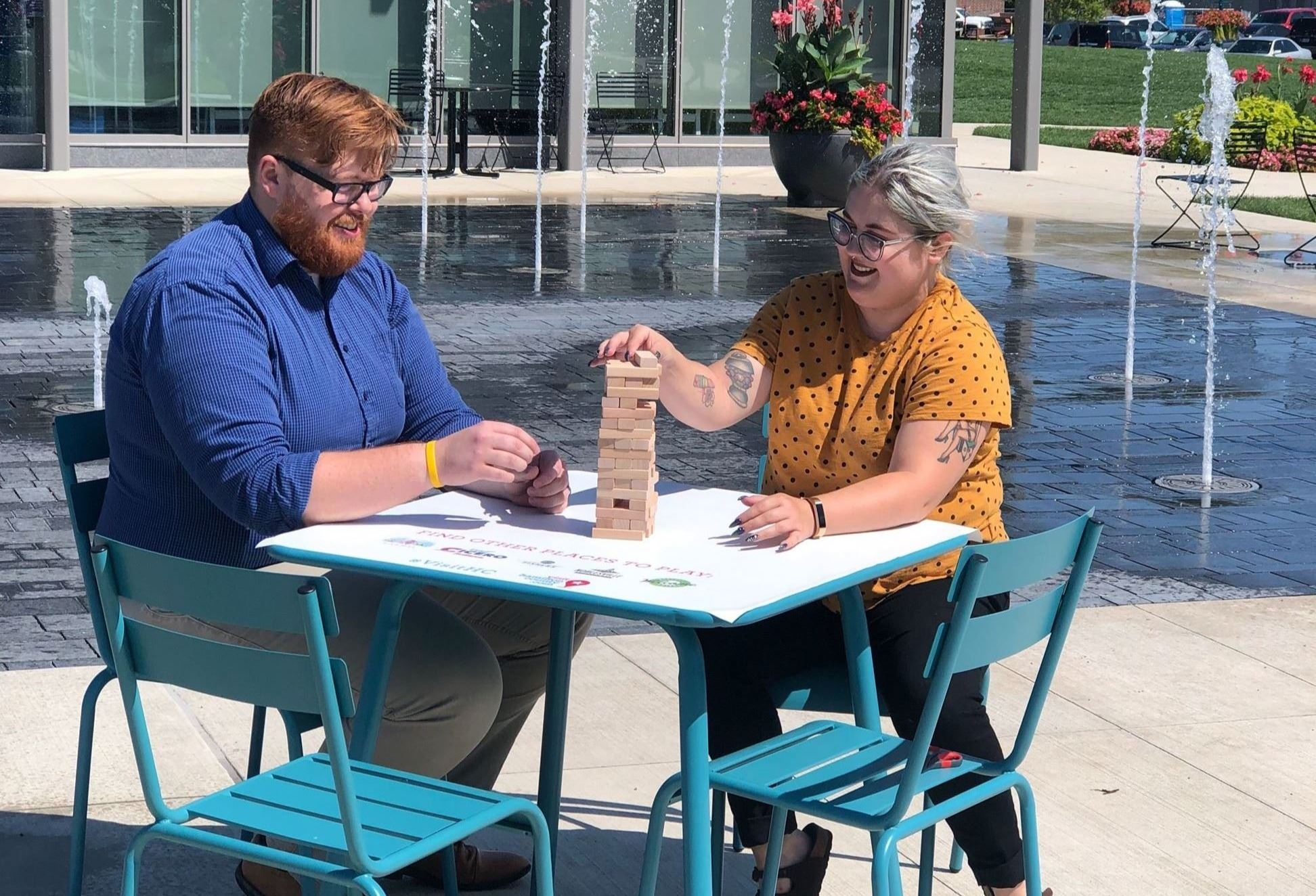 Ross Hilleary & Kelli Jenkins play Jenga at the Turquoise Table in downtown Fishers